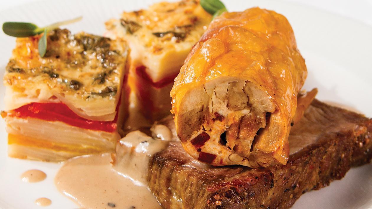 Печен свински врат, пилешко бутче пълнено със сушени наденички, картофи огретен с печени чушки и сос от диви гъби