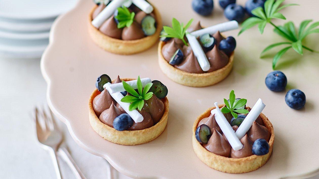 Blåbær og mælkechokoladetærte