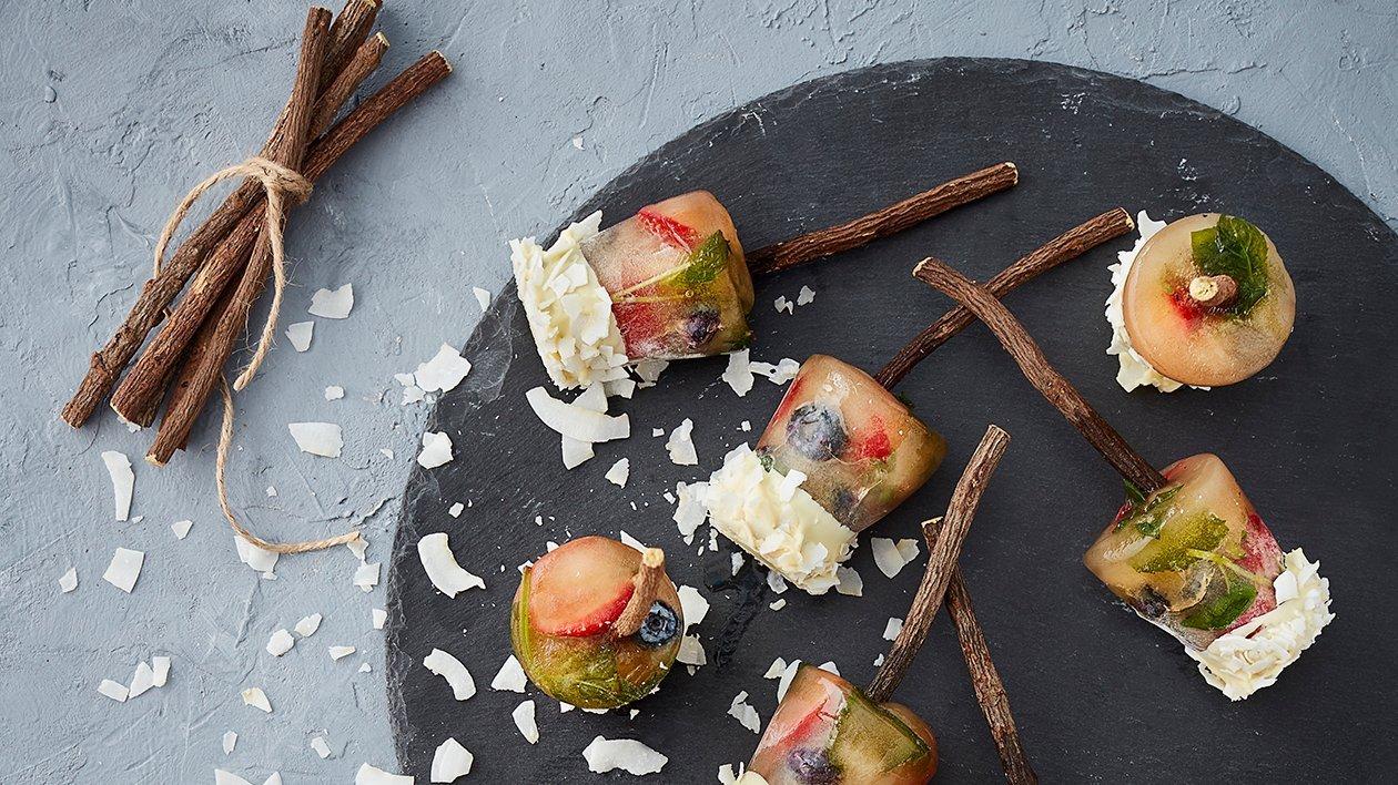 Iste-ispinde med hvid chokolade og kokosflager