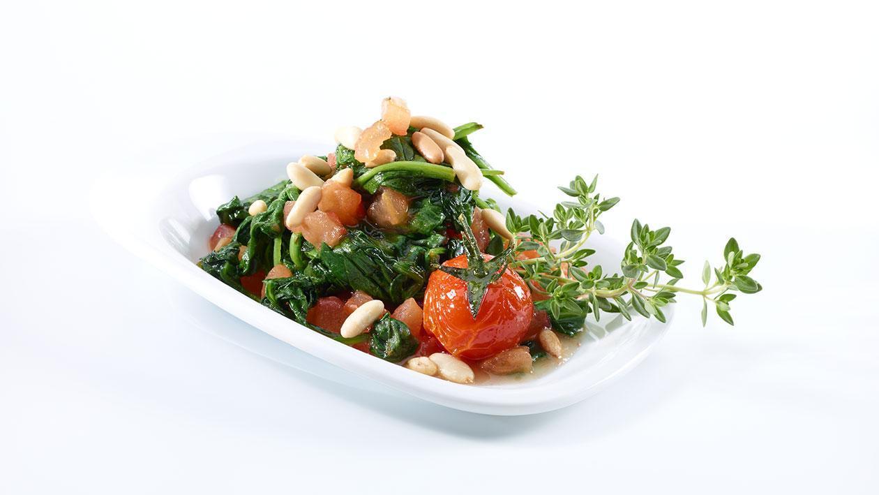 Gedünsteter Spinat mit Pinienkernen und gebratenem Zanderfilet