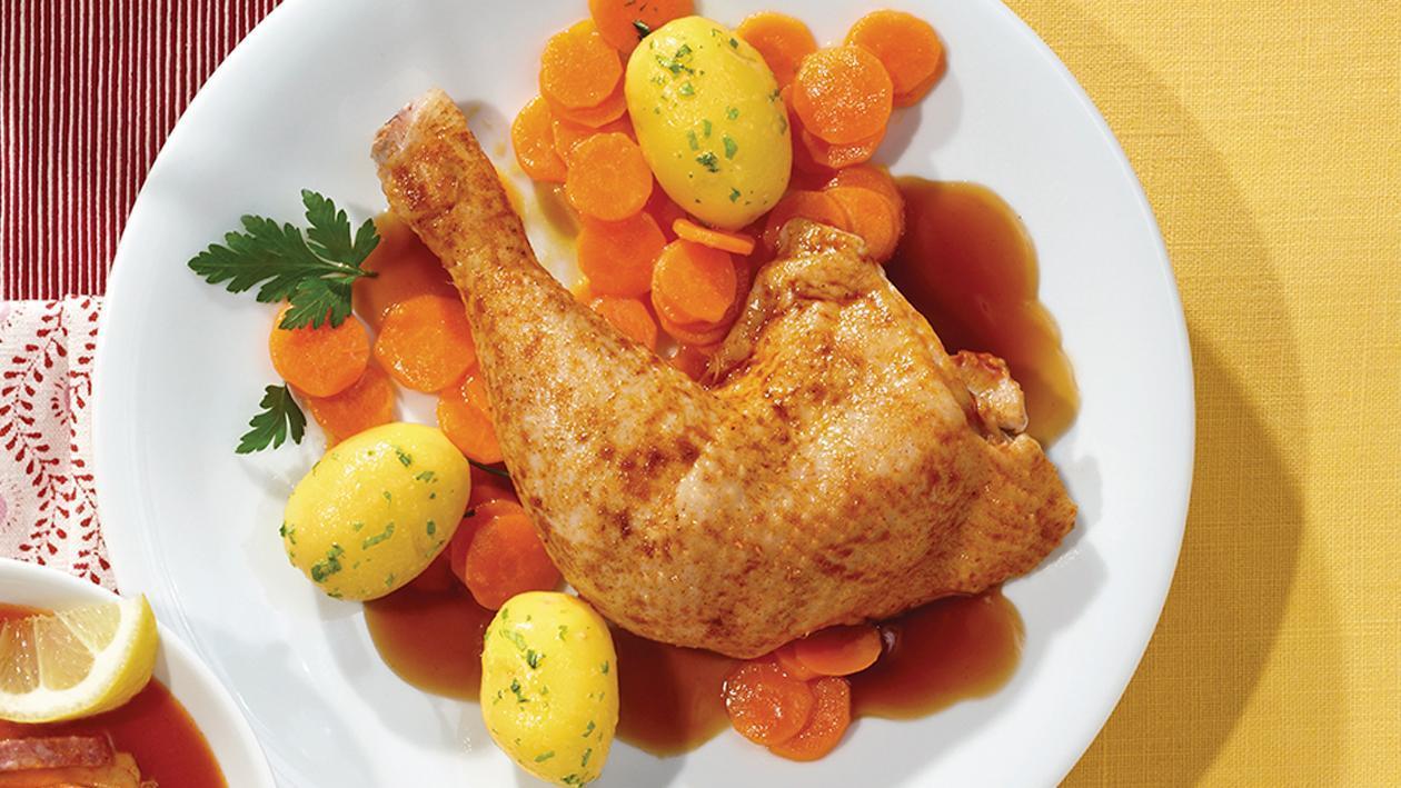 Hähnchenkeule an Geflügeljus mit Ingwer-Karotten und Petersilienkartoffeln