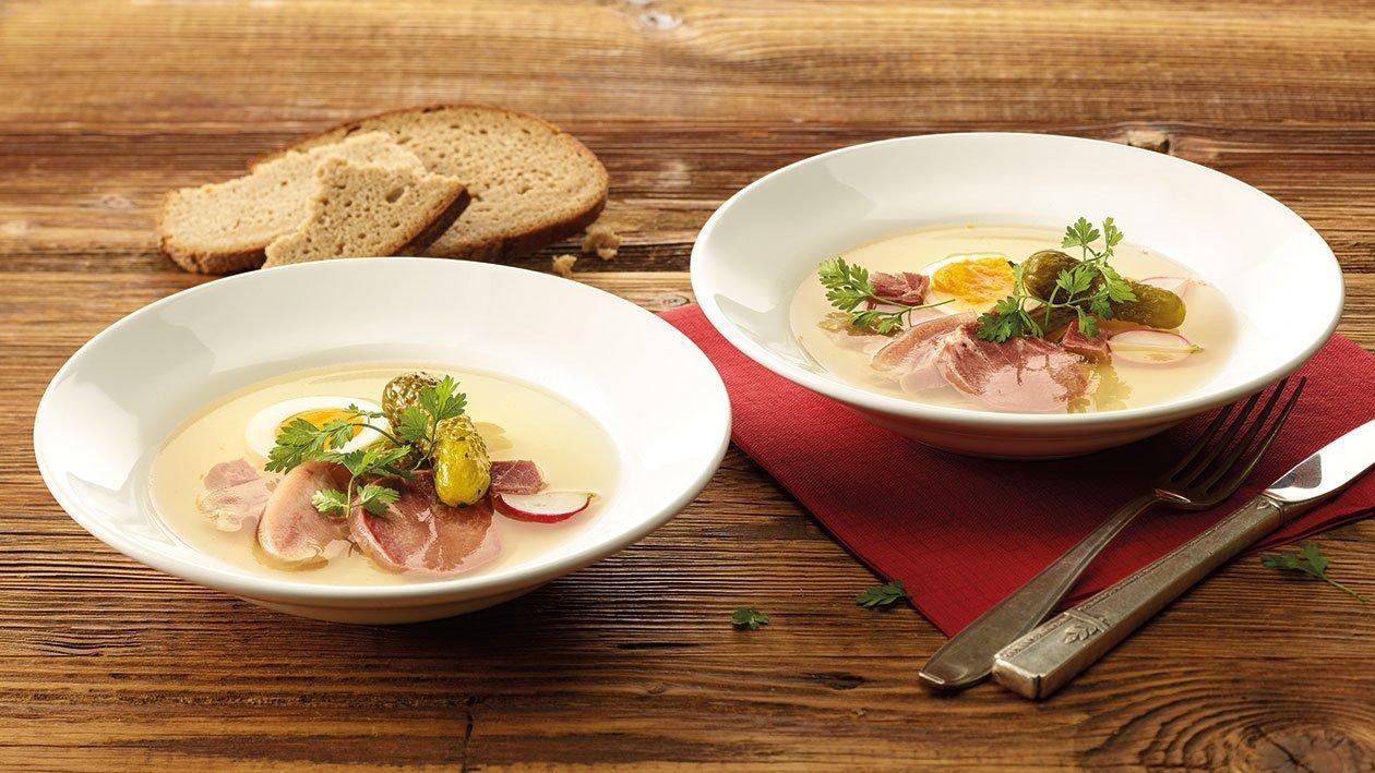Schweinskopf-Sülze mit Eier und Cornichons