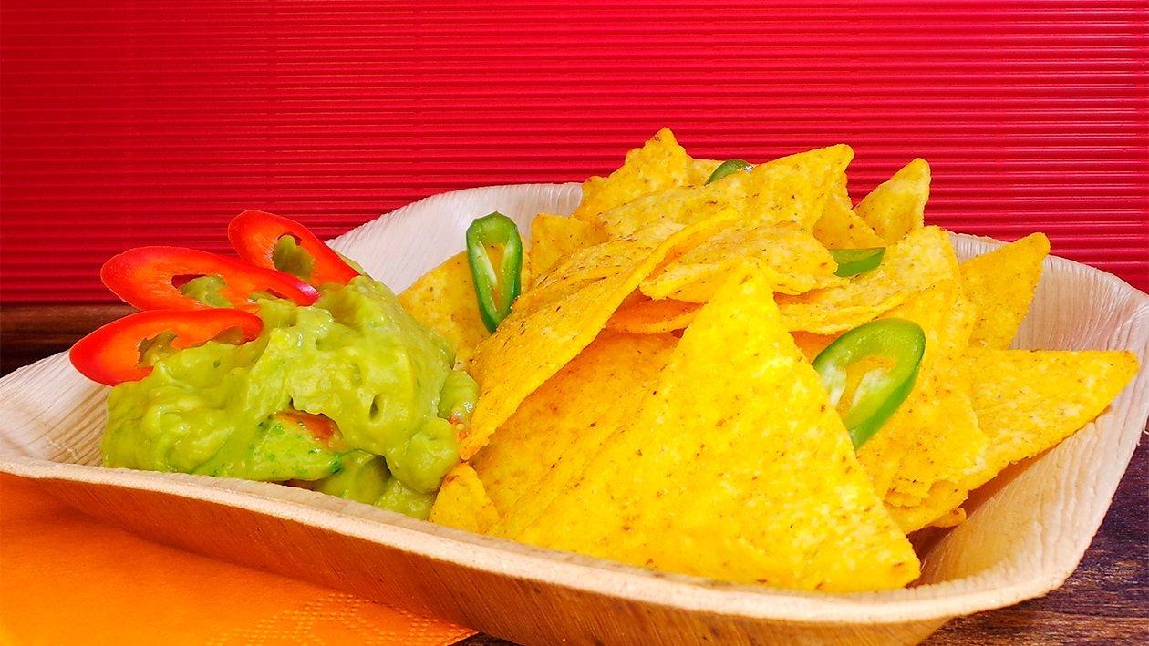 Tortilla Chips in Guacamole