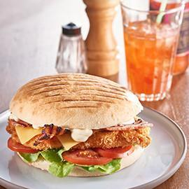 Chicken Schnitzel Turkish with Roma, Swiss Cheese and Honey Bacon