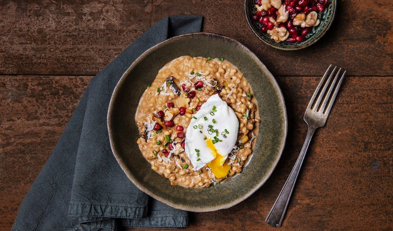 Barley Mushroom Risotto with Poached Egg, Toasted Walnuts and Pomegranate Seeds  – recipe