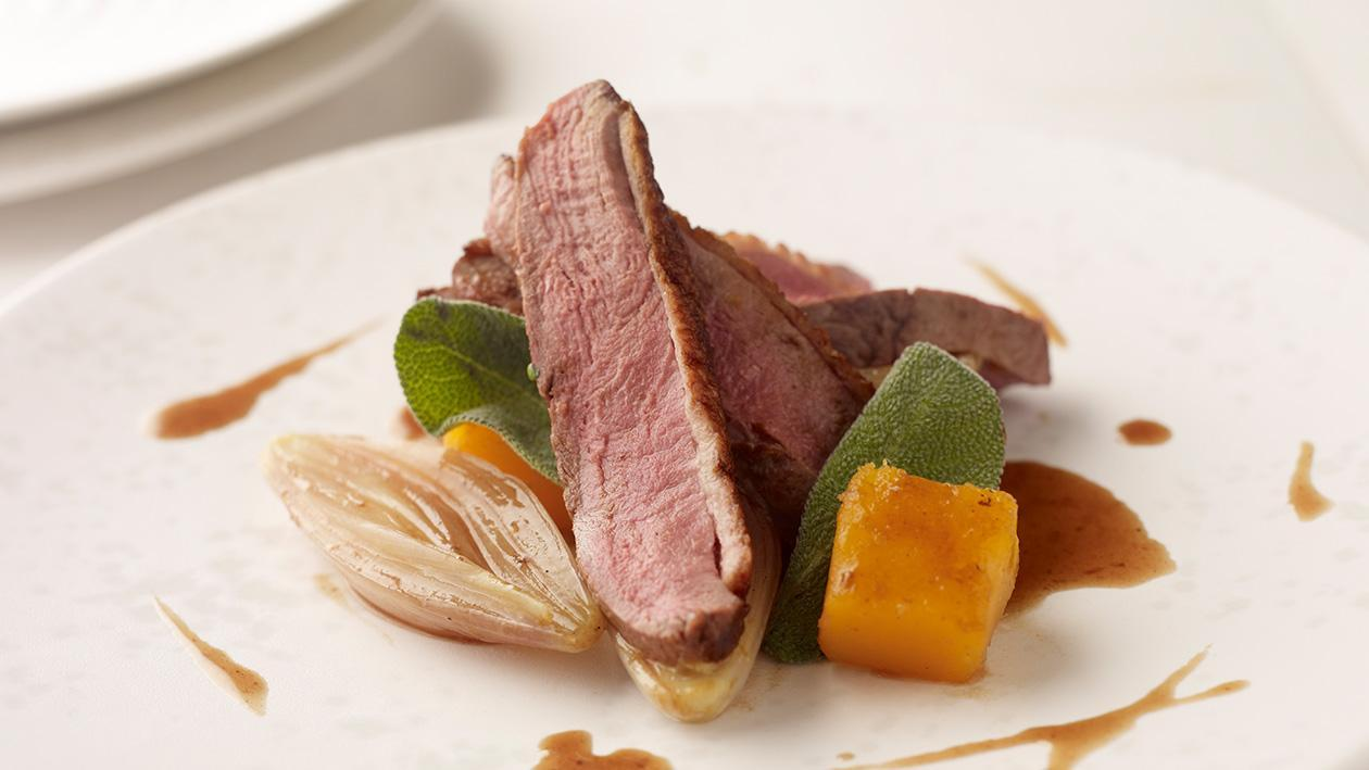 Crispy duck breast with glazed butternut squash and orange star anise sauce – recipe