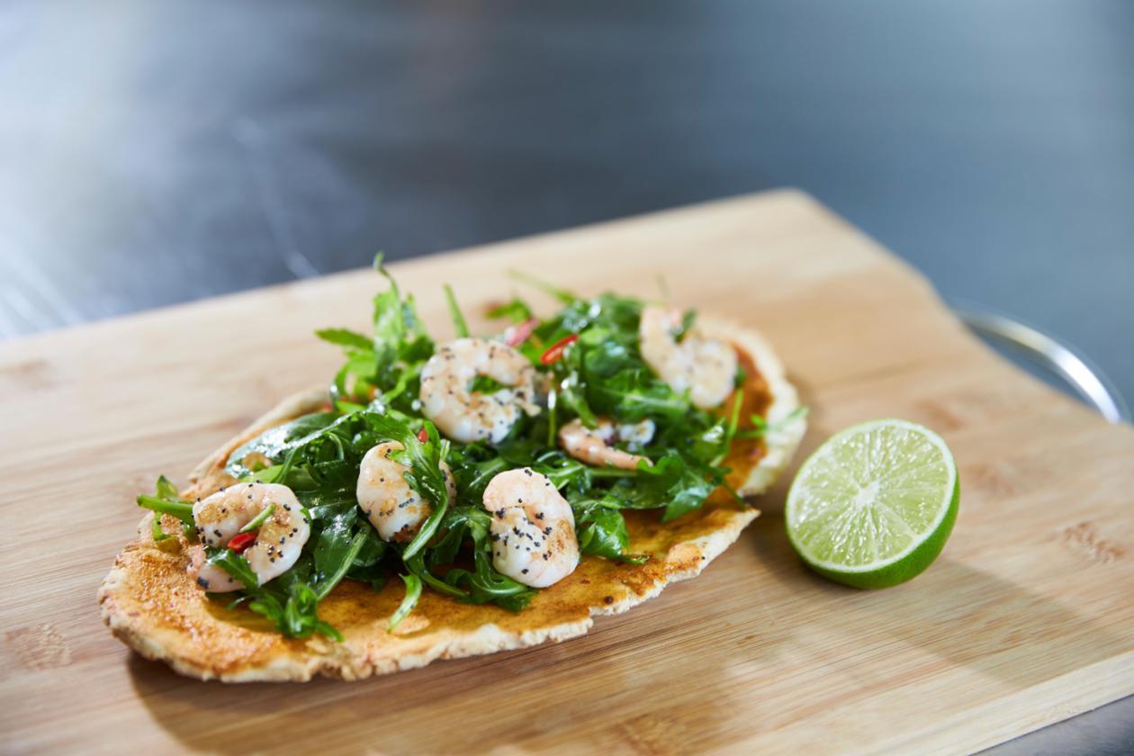 Piri Piri flat bread with lime roasted king prawn salad – recipe