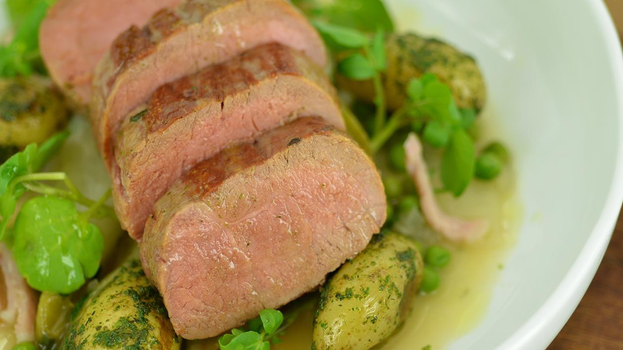 Roast lamb loin with peas, chicory & bacon – recipe