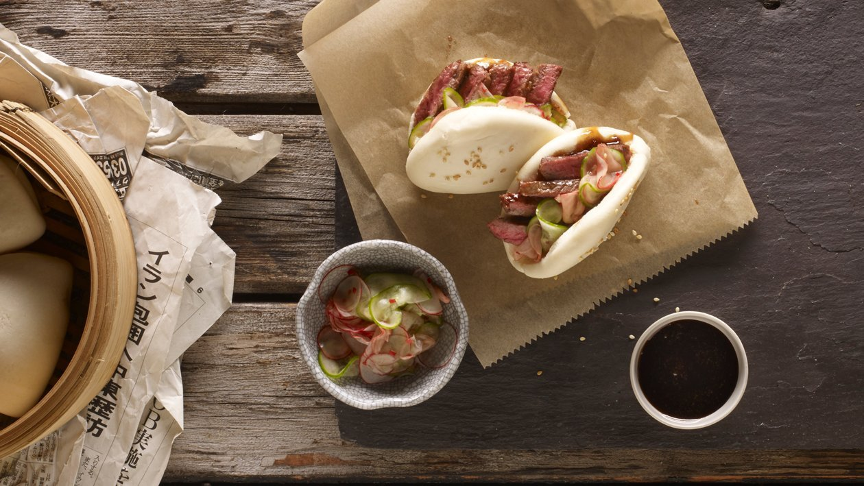 Teriyaki beef buns, cucumber, radish pickles and sticky soy ginger jam