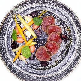 Cured venison with pickled garden vegetables, blackberries and nasturtium leaves
