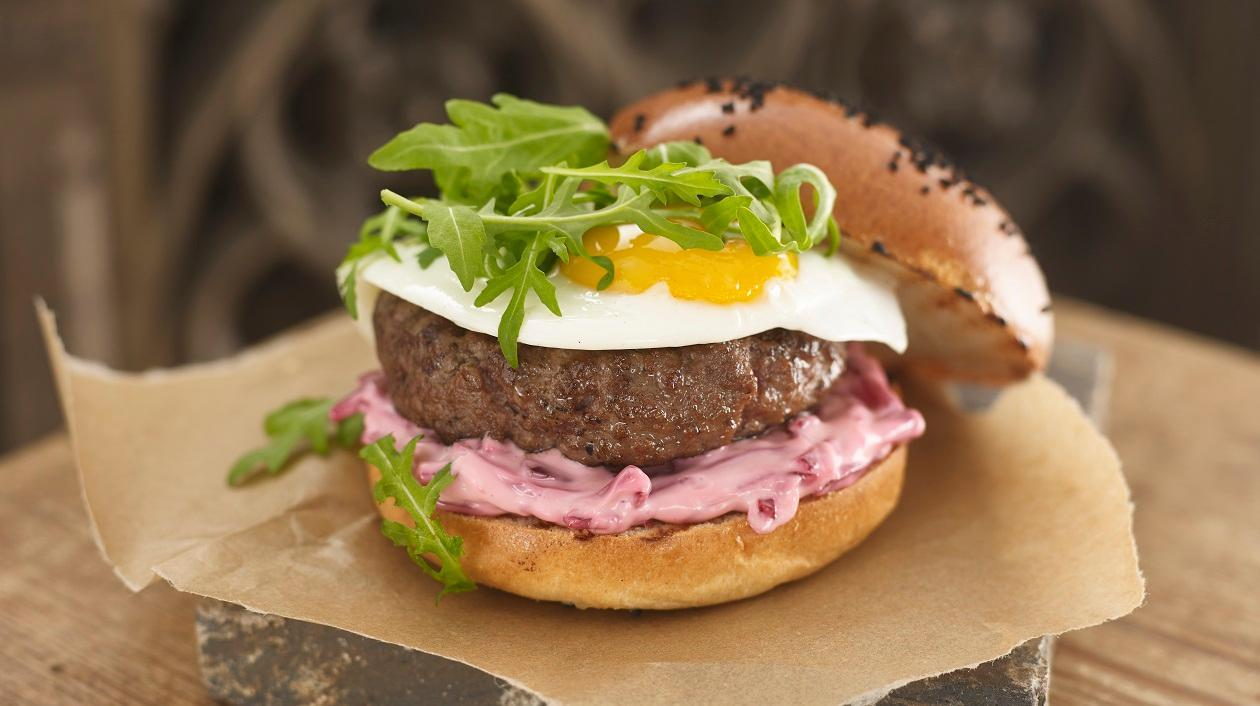 Australian burger with fried egg, beetroot and rocket