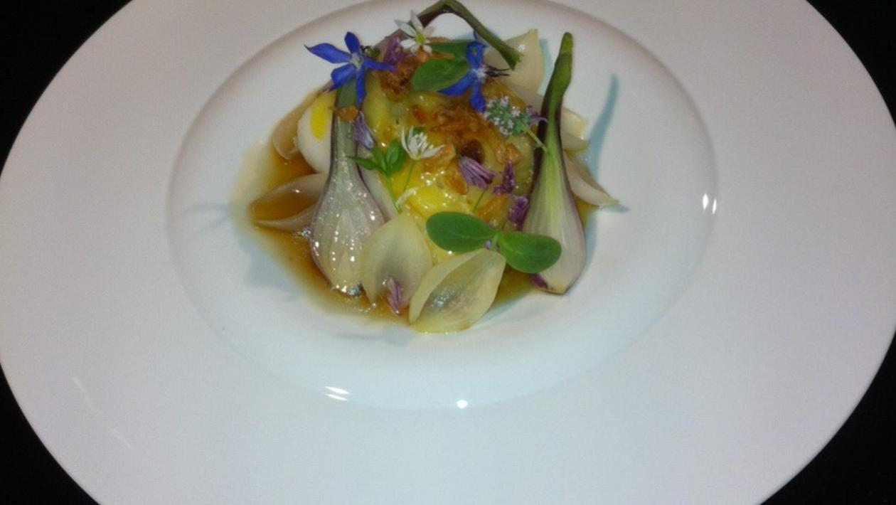 Pan-fried Pollock with Lyonnaise onions, onion consommé