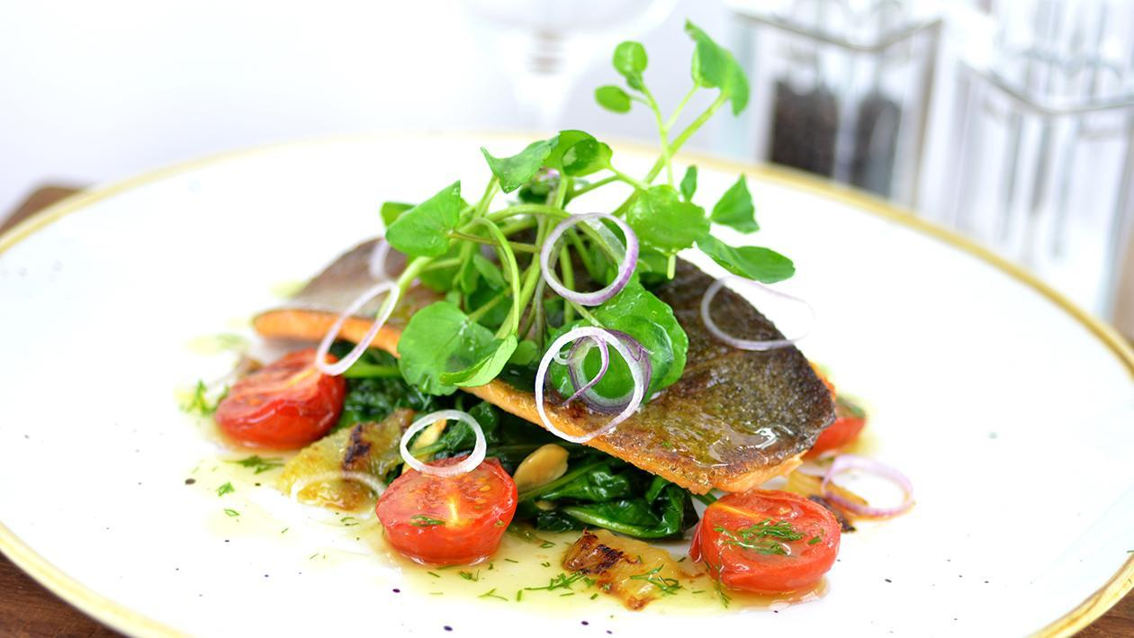 Pan fried trout with almonds, spinach & confit tomatoes