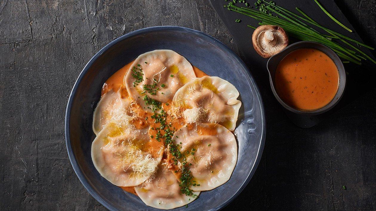 Chicken wonton ravioli topped with parmigiana sauce – Recipe