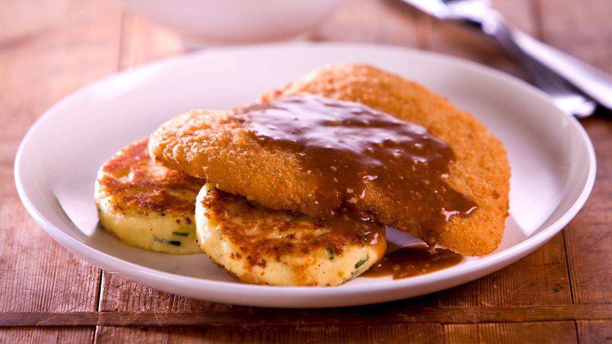Crispy Chicken Schnitzel, Potato, Cheese and Chive Cakes, Roasted Garlic Sauce – Recipe
