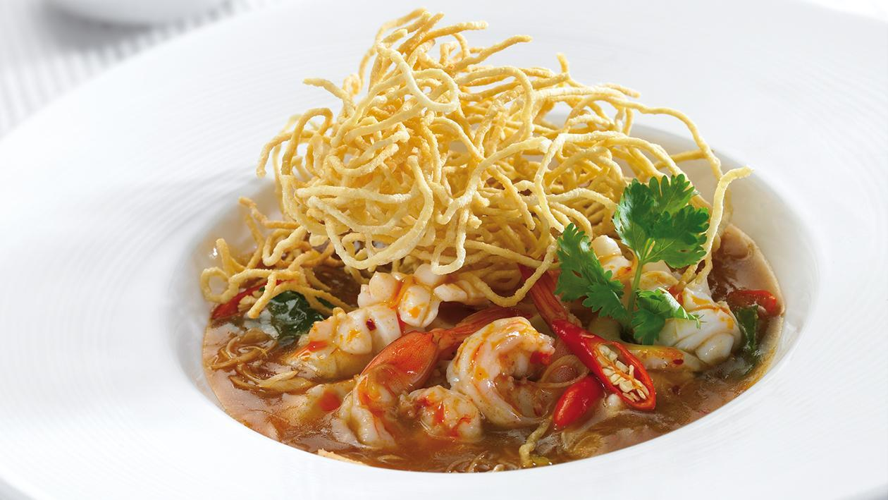 Seafood fried noodle with sour prawn soup