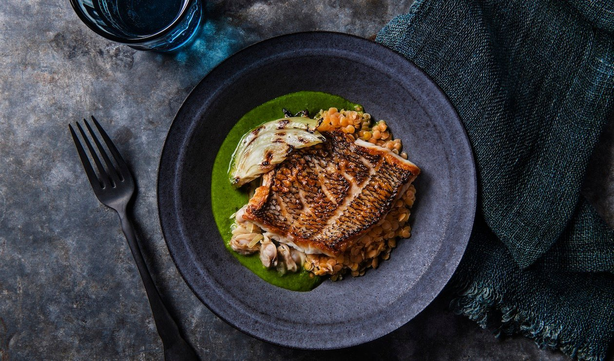 Black Sea Bass with Charred Fennel, Red Lentils and Citrus Ocean Broth – recipe