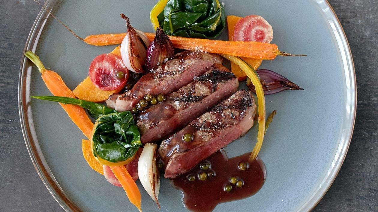 Roasted Rib Eye Steak with Green Peppercorn Sauce