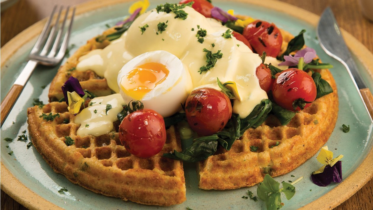 Cauliflower Waffle with Wilted Baby Spinach, Sautéed Baby Tomatoes and Soft Boiled Egg, Topped with Hollandaise Sauce