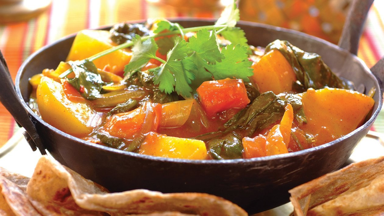 Fiery Spinach Onion and Potato Curry