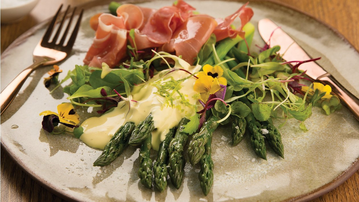 Fresh Asparagus with Parma Ham, Served with Hollandaise Sauce and Lemon Zest