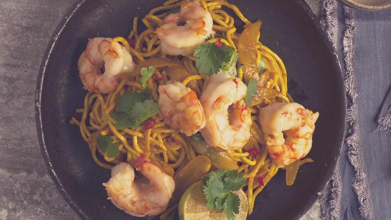 Garlic Prawns on Sauteed Tumeric Noodles with a Lemongrass, Chilli and Lime Dressing