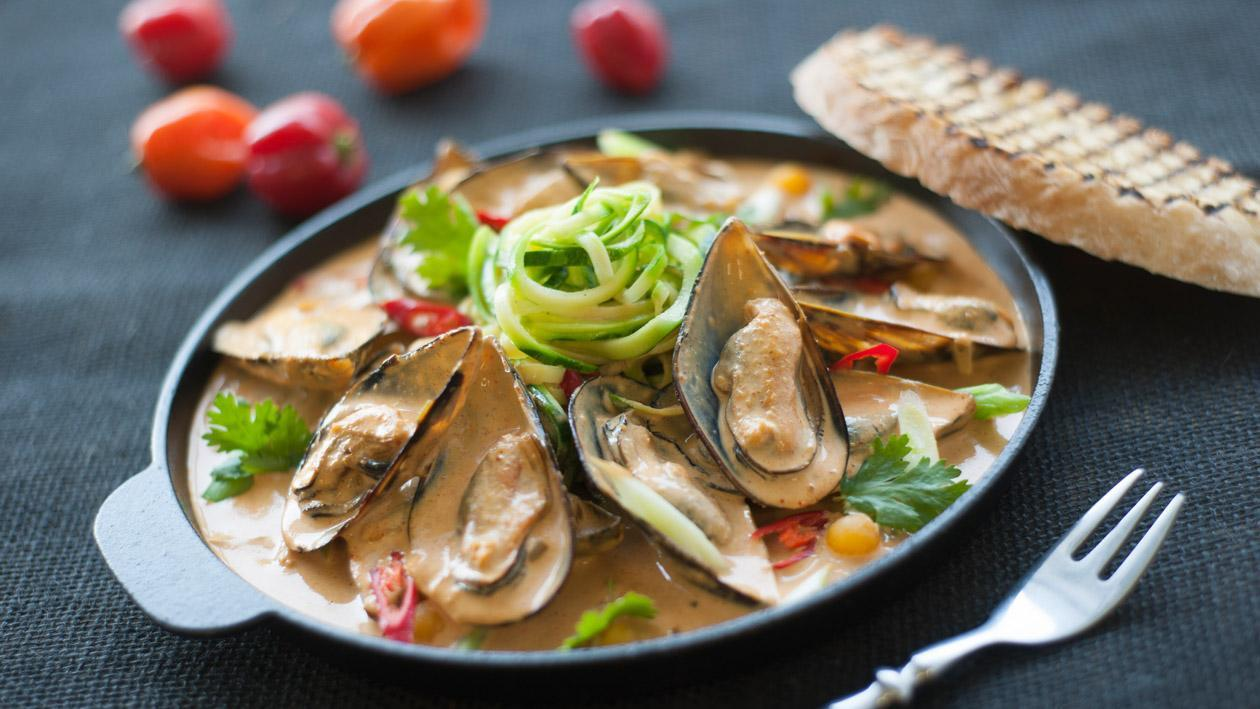 Mussels in a Spicy Coconut Cream on a Bed of Courgette Spirals