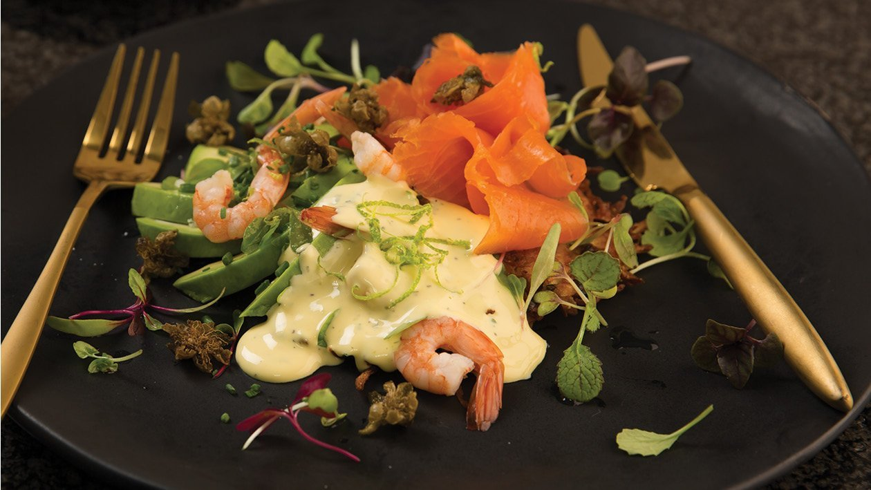 Potato Rosti Stack with Smoked Salmon, Prawn and Avo Drizzled with a Lime and Passionfruit Hollandaise Sauce