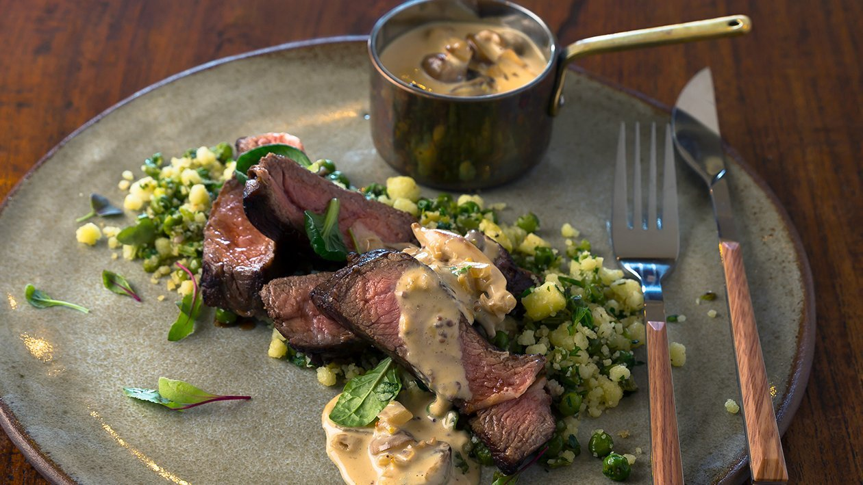 Rump Steak with Green Phutu Pap Served with Mustard and Mushroom Sauce