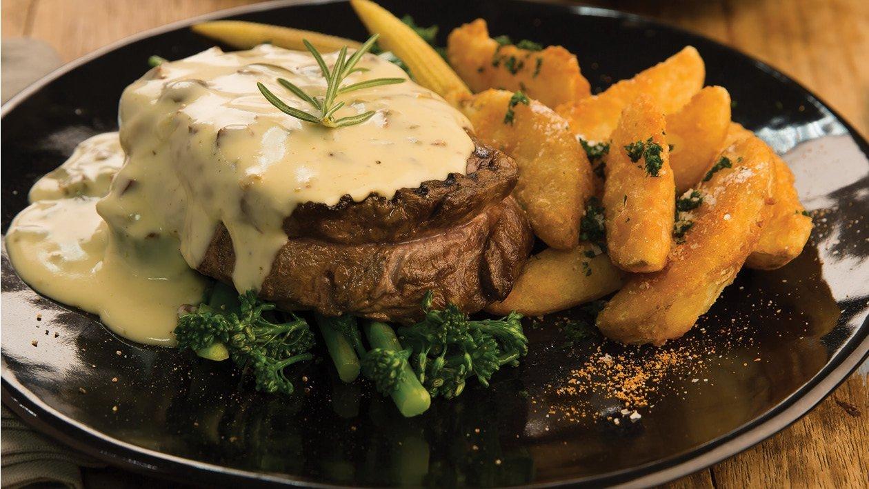 Sliced Grilled Steak With Mustard Hollandaise