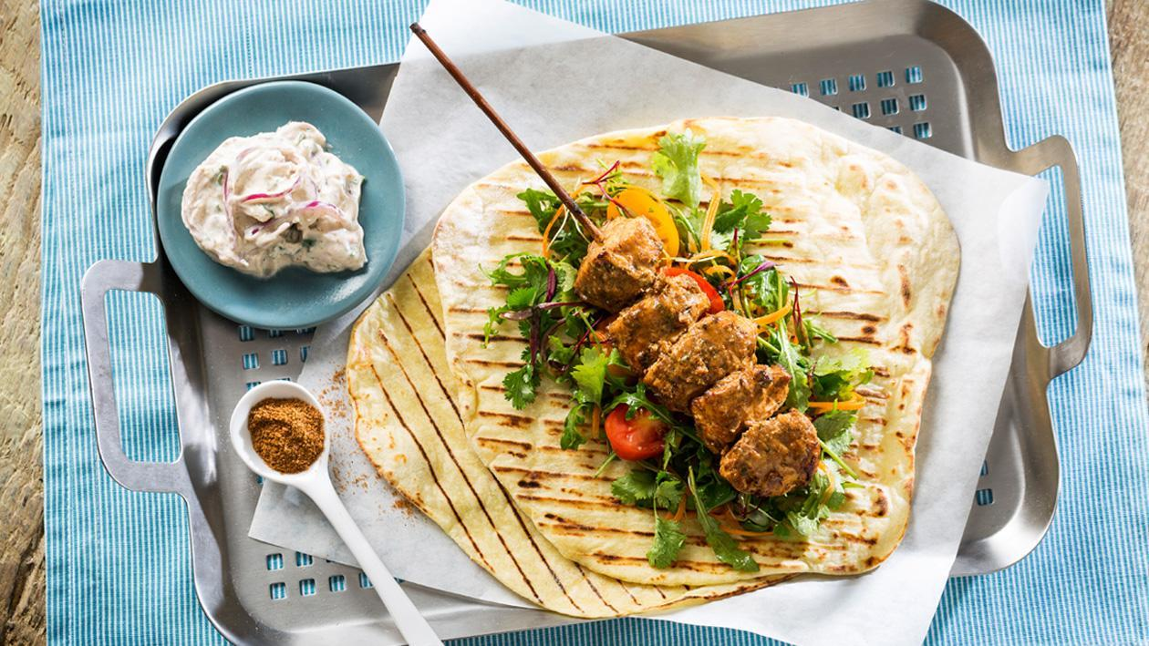 Spicy Bbq Chicken Skewers with Red Onion Tzatziki and Potato Flat Bread
