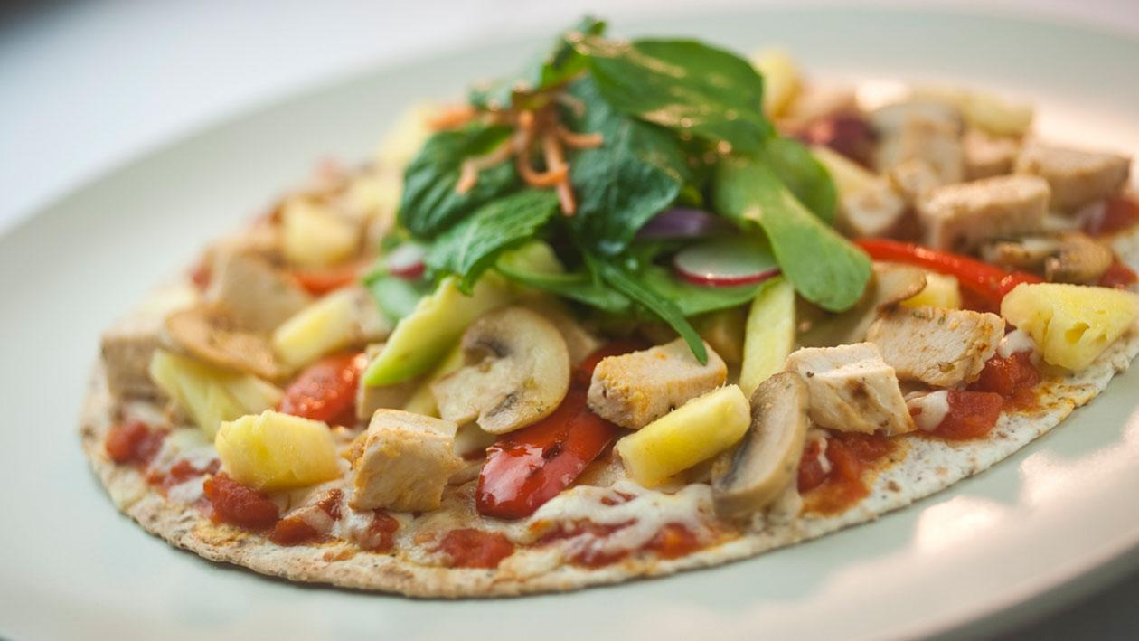Whole grain pizza topped with grillled chicken, fresh pineapple