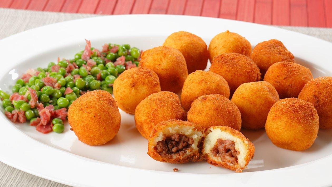 Bombas de patatas rellenas de carne