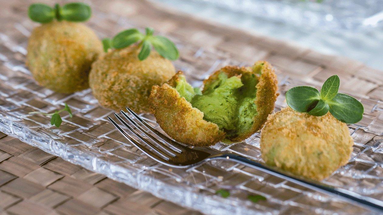Croquetas melosas de merluza en salsa verde