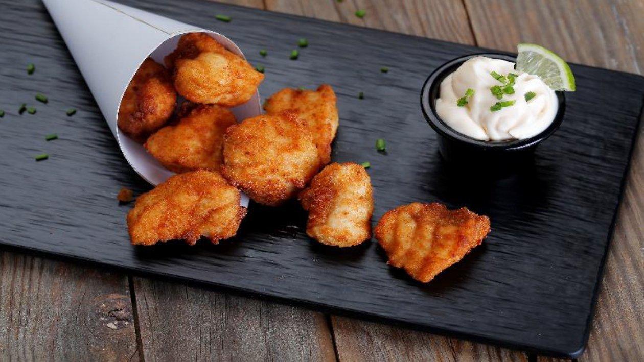 Nuggets de pescado con mayonesa cítrica de lima