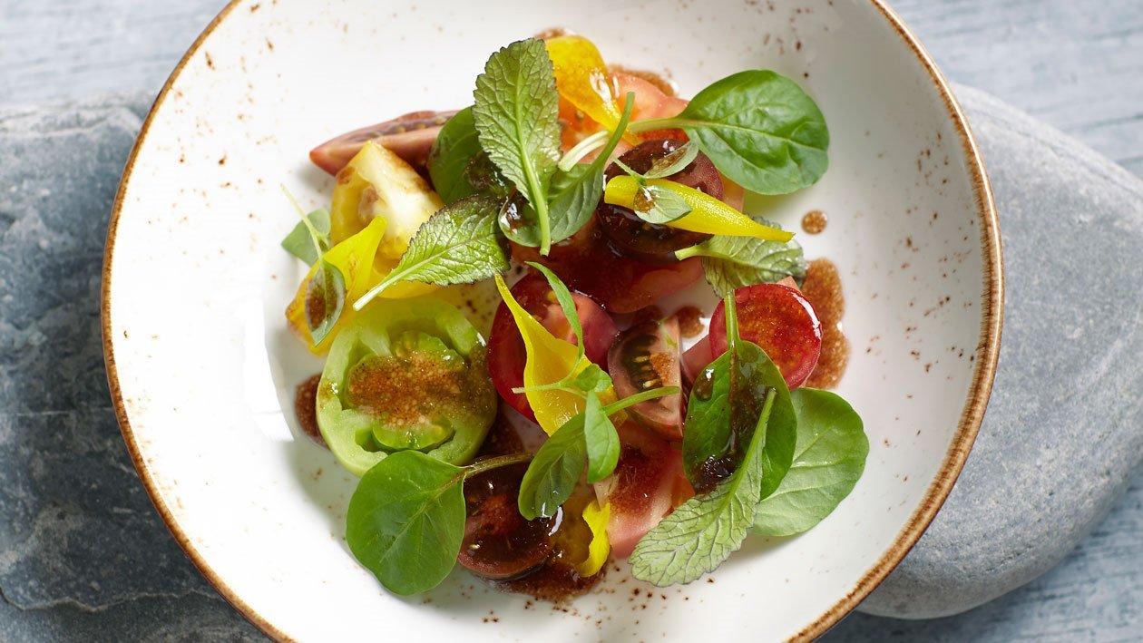 Salade colorée aux tomates et échalotes confites – Recette