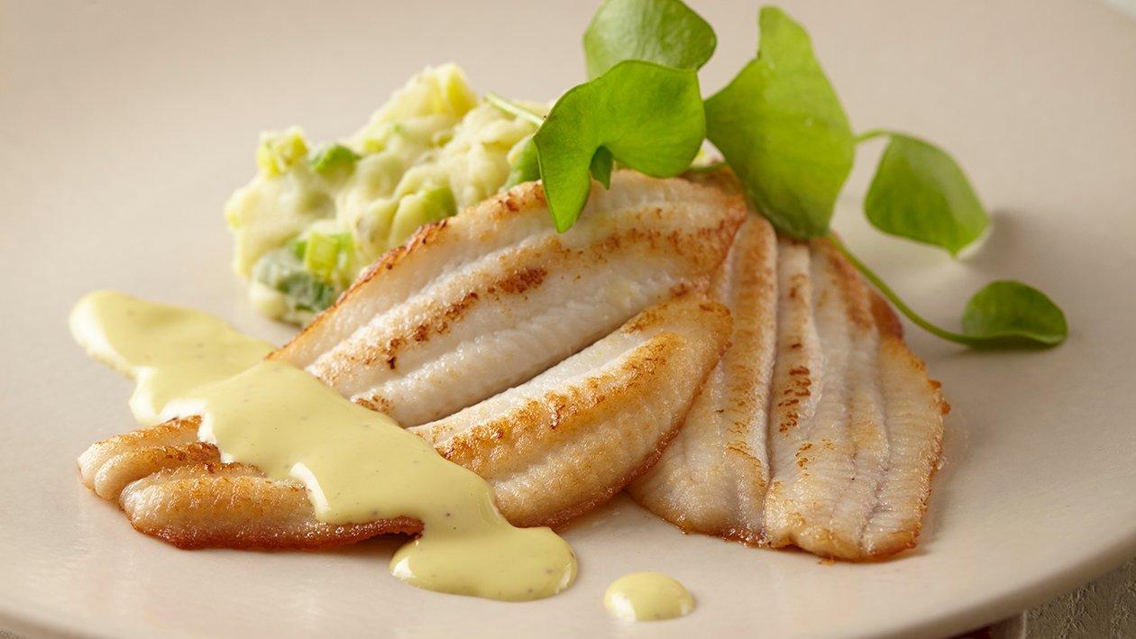 Solette cuite, purée de jeunes poireaux et herbes du jardin, sauce moutarde – Recette