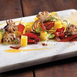 Moscardino cotto in umido con polenta e gremolada di spezie