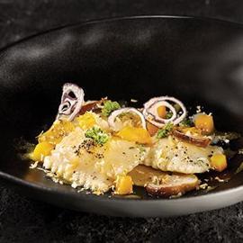 Ravioli di ricotta affumicata con zucca gialla, funghi porcini e rosmarino