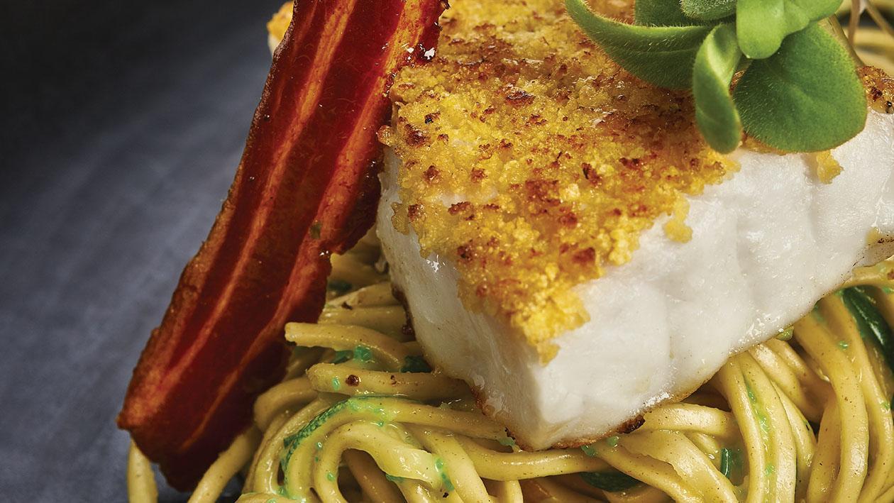 Branzino in crosta di patate e corn flakes su noodles alla carbonara di wasabi – Ricetta