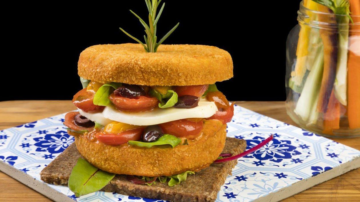 Burger di melanzana panato e fritto, pomodorino infornato, olive taggiasche, provola fusa salsa pomodoro secco e basilico e maionese delux – Ricetta