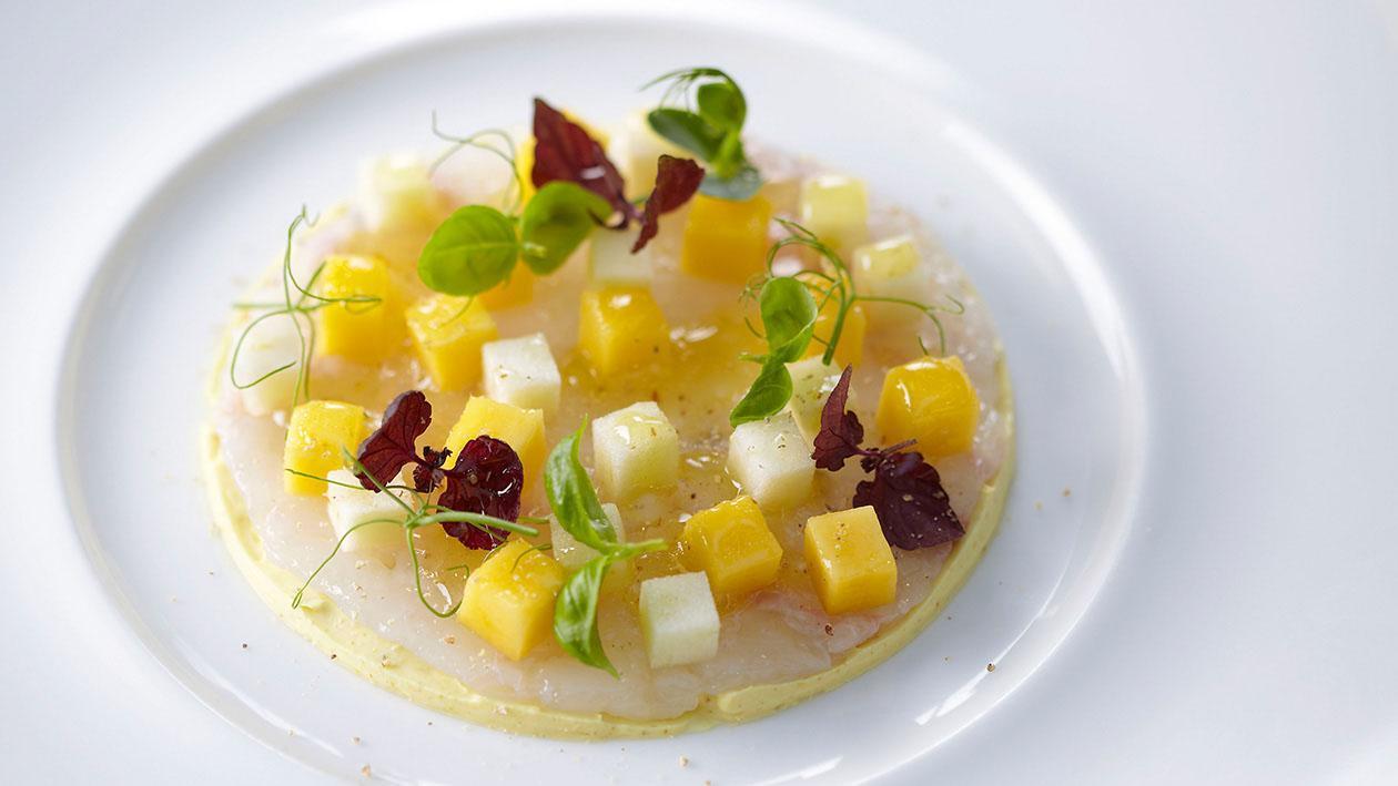 Carpaccio di scampi con curry, mango e mela verde – Ricetta