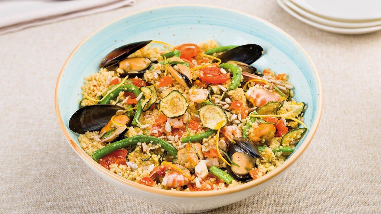 cous cous agrumato ai frutti di mare con fagiolini e semi di girasole – Ricetta