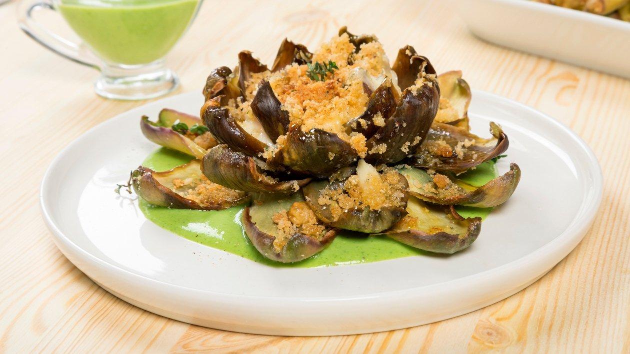 Fiore di carciofo gratinato con cuore fondente di provola affumicata e salsa verde al parmigiano – Ricetta