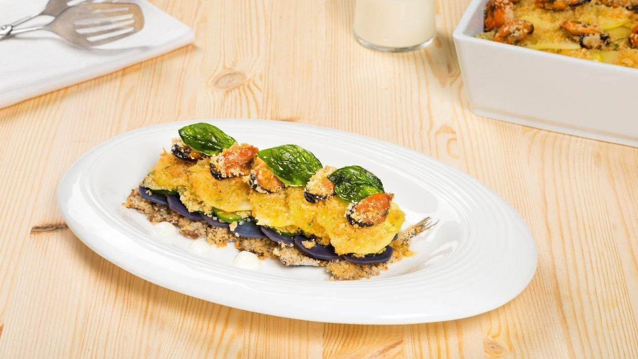 Millefoglie gratin di alici, cozze, zucchine e patate viola – Ricetta
