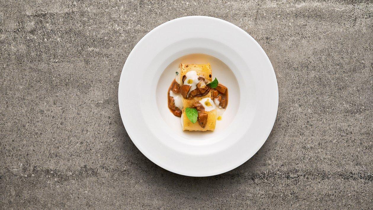 Paccheri gratinati con farcia di ricotta e cedro in salsa ai funghi porcini – Ricetta