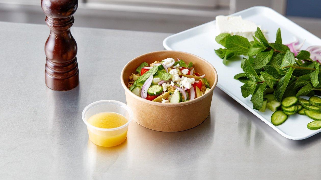 Griekse salade met taboulé en citrus vinaigrette (delivery)
