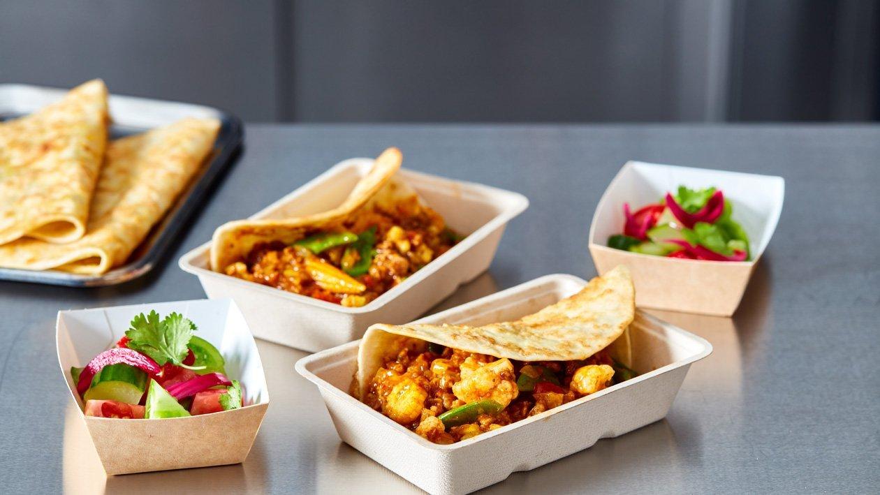 Indiase roti gevuld met vegetarische groenten curry (delivery)