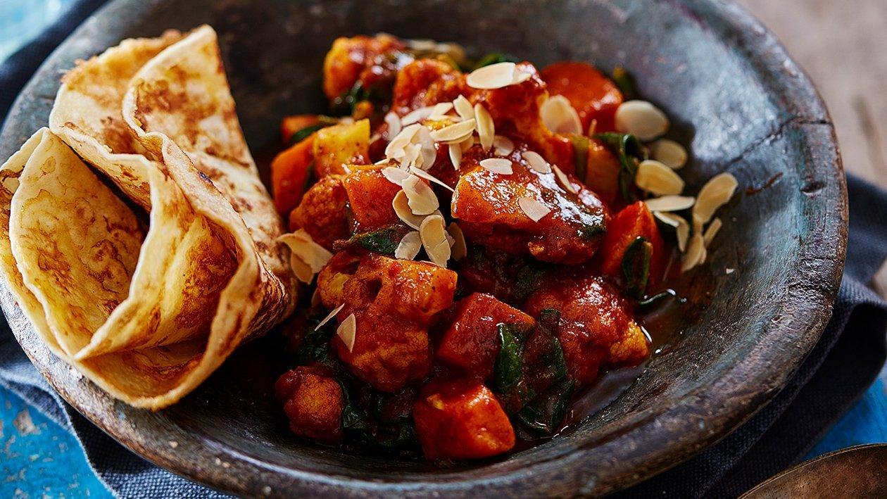 "Roti met bloemkool, aardappels en spinazie ""Madras style"" (vegetarisch)"