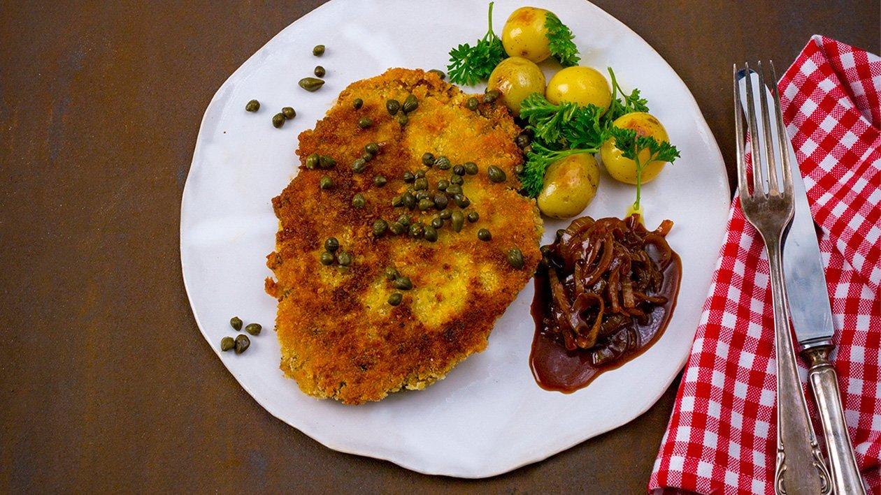 Vegetarschnitzel med kapers, stekte potetkuler, løksjy og fritert persille – Oppskrift